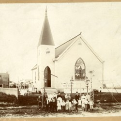 Lawn Festival, portrait of people in front of first church building, c. 1897